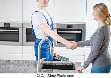 Worker givng a handshake
