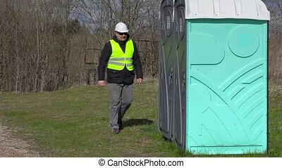 Worker go to in portable toilet
