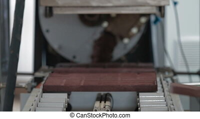 Worker hand takes plastic tile from stamping press -...