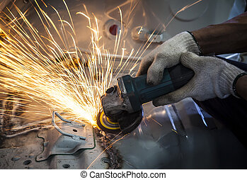 worker hand working by industry tool cutting steel with ...