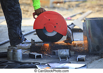 worker hand working by industry tool cutting steel with split fire use for industrial manufacturing theme