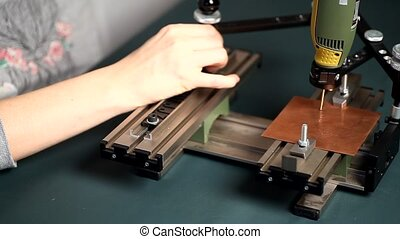 Worker hands on Engraving device pantograph with engraver with letterpress alphabet 4K