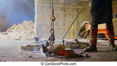 Worker hanging metal casting with overhead crane 4k - Worker...