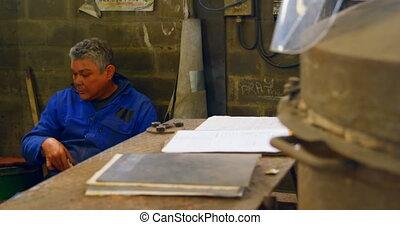Worker having food in foundry workshop 4k - Worker having ...