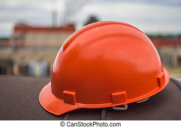 Worker helmet on the factory