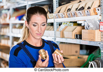 Worker holding a high-quality pipe fitting accessory in a...
