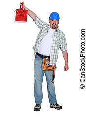 Worker holding aloft a toolbox