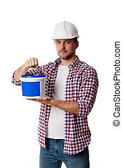 worker holding can with paint.