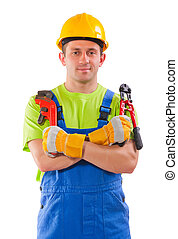 worker holding pipe wrench and steel cutter