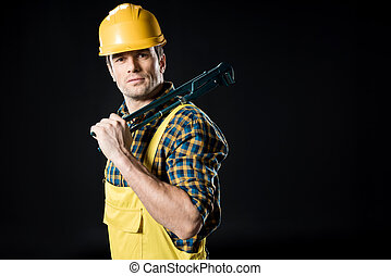 Worker holding pipe wrench