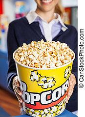 Worker Holding Popcorn Bucket At Cinema