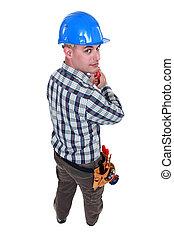Worker holding screwdriver