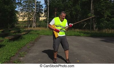 Worker imitates a guitar game during work