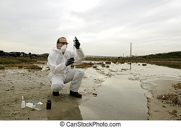 Worker in a protective suit examining pollution in the water...