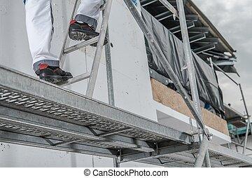 Worker in a Scaffolding