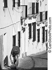 Worker in a traditional spanish rural village in Cadiz. Spain