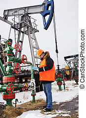 Worker in an oil field.