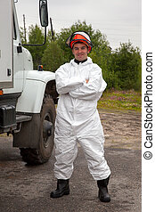 Worker in bio-hazard suit