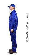 Worker in blue workwear. Side view.