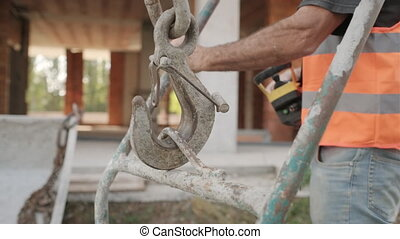 Worker In Construction Site With Hardware To Make Cement