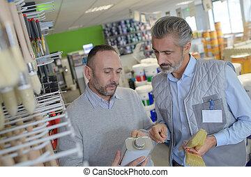 worker in diy store advising customer