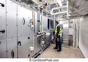 Worker in electrical switchgear room
