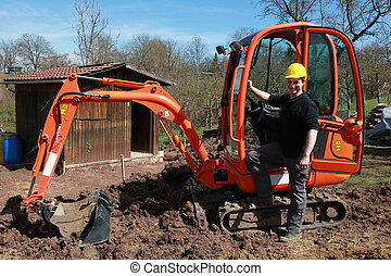 Worker in front of an excavator
