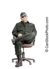 Worker in glasses sitting on chair.