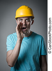 worker in helmet cry