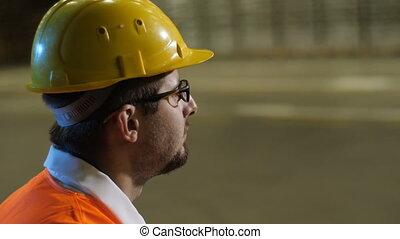 Worker in Helmet eating sandwich - Engineer in bright orange...