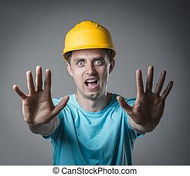 worker in helmet surprised