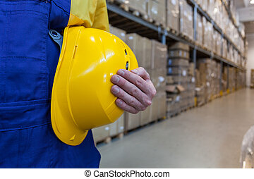 Worker in high bay warehouse
