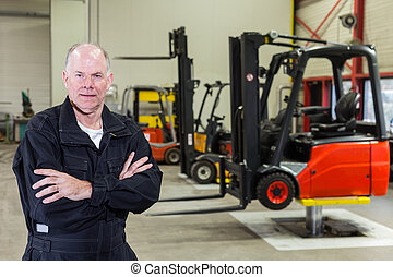 worker in maintenance service station - man standing in...