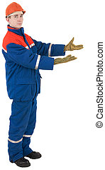 The worker in overalls and a helmet on a white background