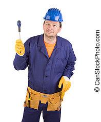 Worker in protective helmet with instruments.