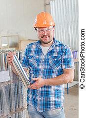 Worker in safety helmet at the storage