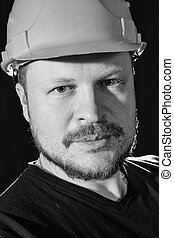 Worker in safety helmet portrait - Handsome worker in safety...