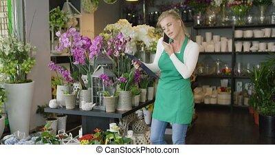 Worker in shop talking phone