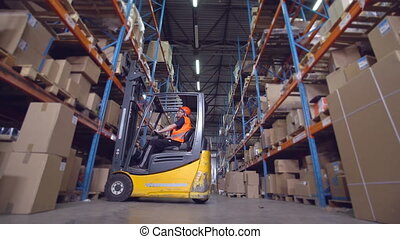 forklift operator puts boxes with goods on the metal racks