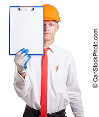 worker in the helmet shows a sign