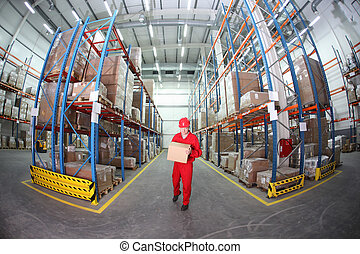 worker in uniform carrying box