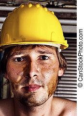 Worker in yellow helmet