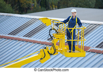 worker inspecting building roof