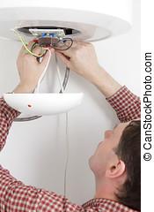 Worker installing a water heater