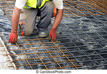 Worker installing reinforcement mesh
