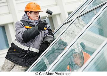 worker installing window