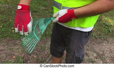 Worker is correcting the branches of the rake