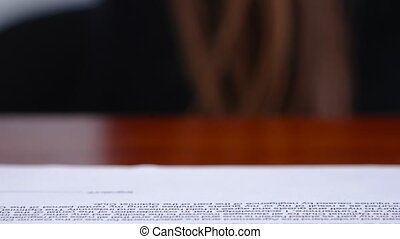 Worker is doing office work on documents with a rectangular...