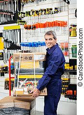 Worker Keeping Tool Package On Trolley