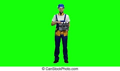 Worker keeps a movie cracker. Green screen - Worker keeps a...